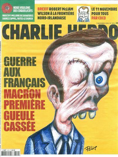 """Макрон с """"зашитым глазом"""" попал на обложку Charlie Hebdo. Фото"""